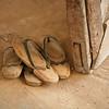 Wooden shoes left beside the door.