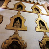 Buddha images sit in niches throughout the temple interior.