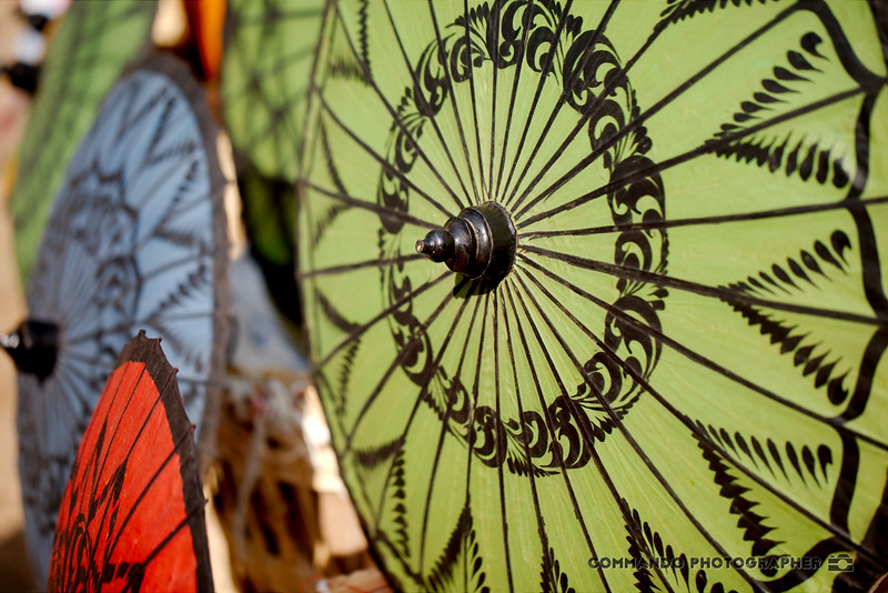 Colorful lacquered parasols in the market.