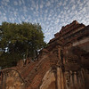 A rippled cloud-covered sky hangs over a temple next to Ananda temple.