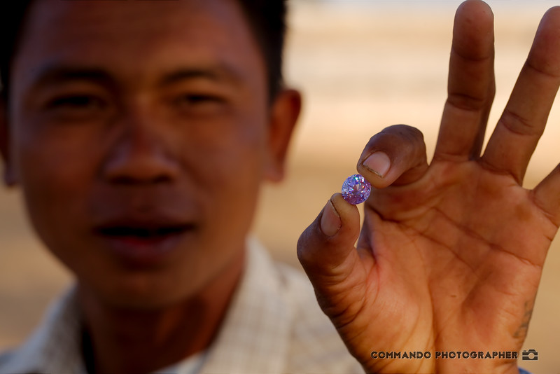 A vendor shows off one of his stones.