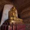 A golden statue sits forever in meditation.