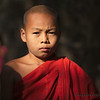 A young monk poses for a portrait.