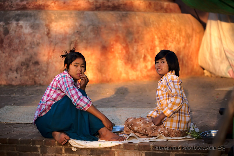 Two women enjoying a meal at the end of the day.