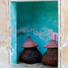 Water jugs rest in their niche on a monastery grounds.