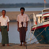 Boatmen pose beside their craft.