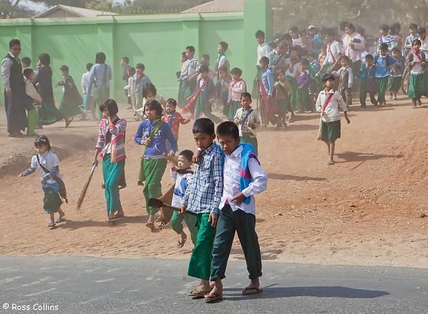 School children leave school for their lunch break, New Bagan, Myanmar, 1 February 2013