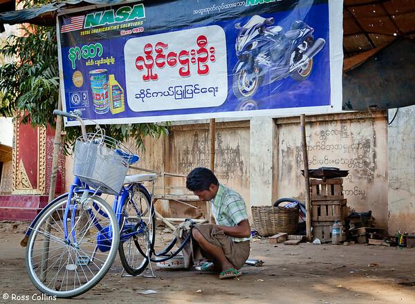 Bicycle puncture repair in Myinkaba Village, Bagan, Myanmar, 2 February 2013