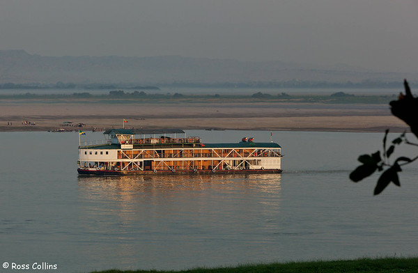 """The boutique cruise vessel """"RV Paukan 2007""""on the Ayeyarwady River at Bagan, Myanmar at first light, 29 January 2014"""