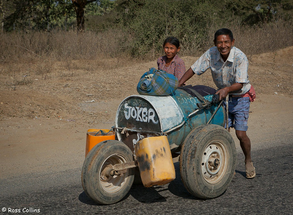 A couple push their water cart in New Bagan, Myanmar, 2 February 2013