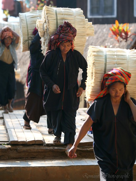 Hill tribe women bring goods to the dock.