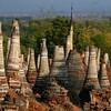 The ruins of stupas poke through the land like alligator teeth.
