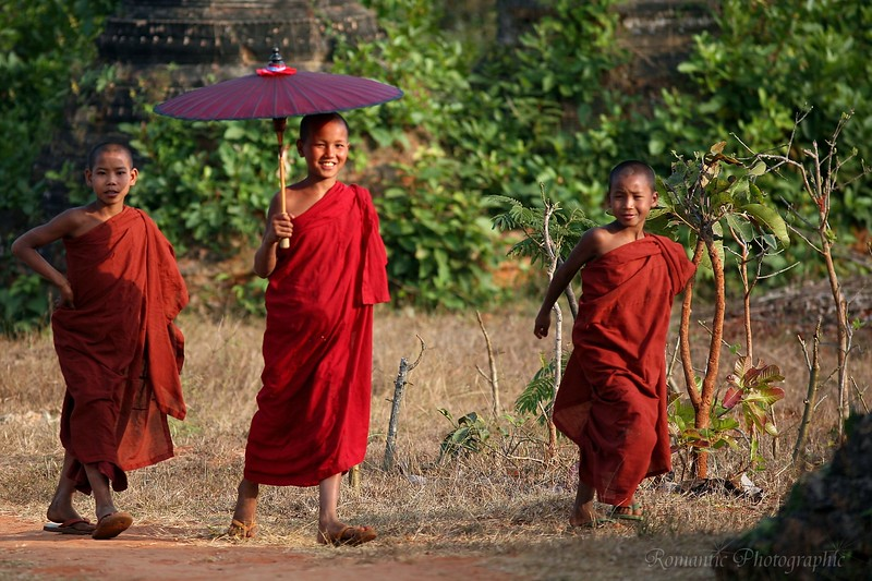 Young monks make their way through the ruins.
