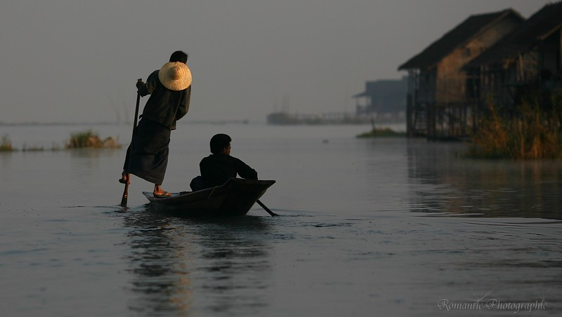 Two men paddle home at the end of the day.
