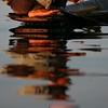 A man prepares his fishing line.