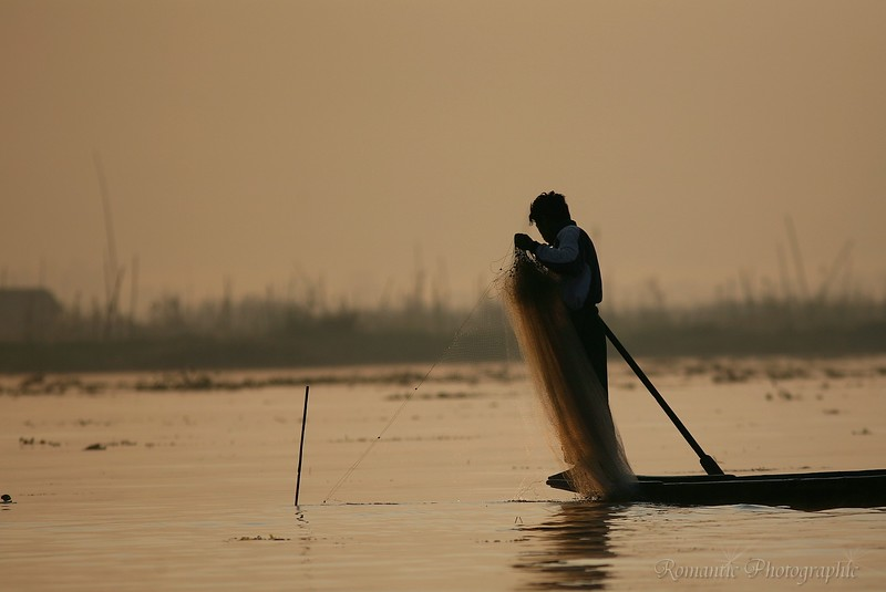 A fisherman prepares to cast his net.