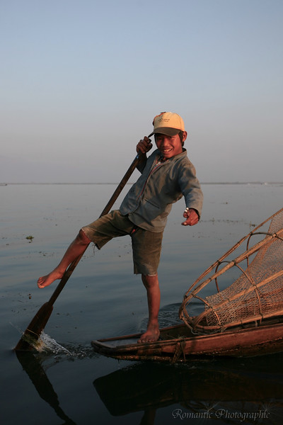A young boy demonstrates the leg-rowing technique.
