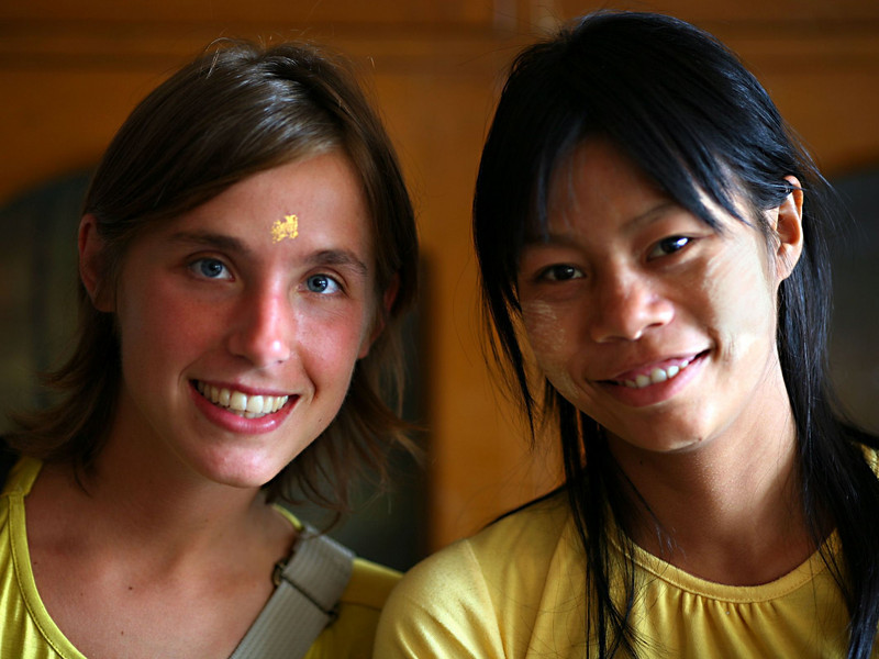 A Dane, with a speck of gold leaf placed on her forehead, poses with one of the shop supervisors.