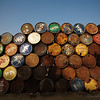 Empty fuel barrels are stacked up, waiting to be refilled.