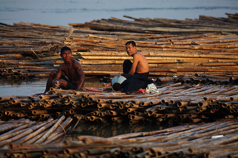 Two men wash up on the bamboo rafts.