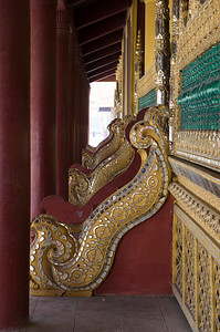 "Built by King Mindon between 1857 and 1859 and inherited by King Thibaw before colonial times, Mandalay Palace was the last Burmese royal citadel to be built in Burma. The palace follows a traditional model, sitting within a square moated fort. Each of the four walls is two kilometres in length with a wide moat running around the outside. Each wall has a gate, but tourists are only permitted to enter via the eastern gate on 76th Street. The Mandalay Palace's formal name in Burmese is Mya Nan San Kyaw (မြနန်းစံကျော်). It is also known as ရွှေနန်းတော်ကြီး), or the ""Great Golden Royal Palace""."