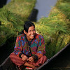 A young woman gives me a smile as she sits in her loaded canoe.
