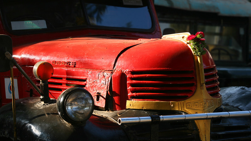 An ancient, but well loved, truck used to haul produce into the market.