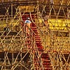 A lattice of bamboo scafolding allows workers access to the outside of the pagoda.