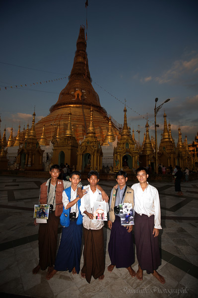 Official photographers pose before the magnificent Shwedagon Pagoda in Yangon, Myanmar.
