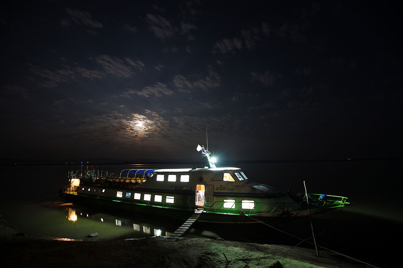 The high-speed boat to Mandalay looks like an amphibious dinosaur resting on the bank.