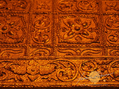 The intricate details of the golden walls of the Botataung maze hallway