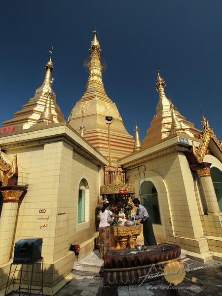 People bathing Buddha at Sule Paya