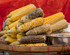 Corn cobs of differing appearances at a street stall © 2013 Ross Collins