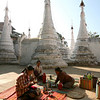 Villagers picnic among the stupas behind the market.