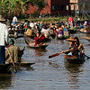 Villagers make their way to and from the market by canoe.