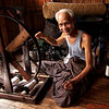 Traditional weaver and weaving loom