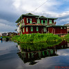 Refection in the water of a local village house, Inle Lakes