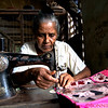 Sewing in the local market using antique machines