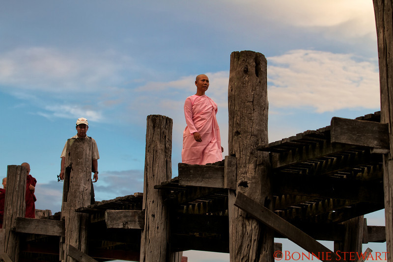 U Bien Bridge at sunset, an aging teak bridge where villagers gather to enjoy life and to buy things at the markets nearby, Mandalay