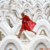 Young monk having fun on the terraces of the Hsin Phyu Mae Temple just north of Mandalay
