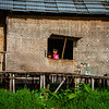 Little girl and her father looking out the window in the floating villages of Inle Lakes