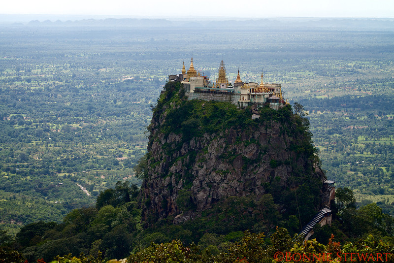Mount Popa, a place of pilgrimage for the local Burmese and home of the nats.  Nats are the spirits of dead nobles and folk heroes and are potentially bad spirits.  Locals climb the mountain to make offerings to the nats.   The mountain is the product of an ancient volcanic eruption