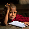 Young monk studying