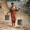 Girl carrying water from the well to her home
