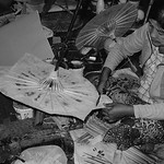 Burmese woman making paper umbrella