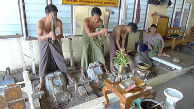 Mandalay: Making gold leaf. Applied to Buddha statues at shrines.