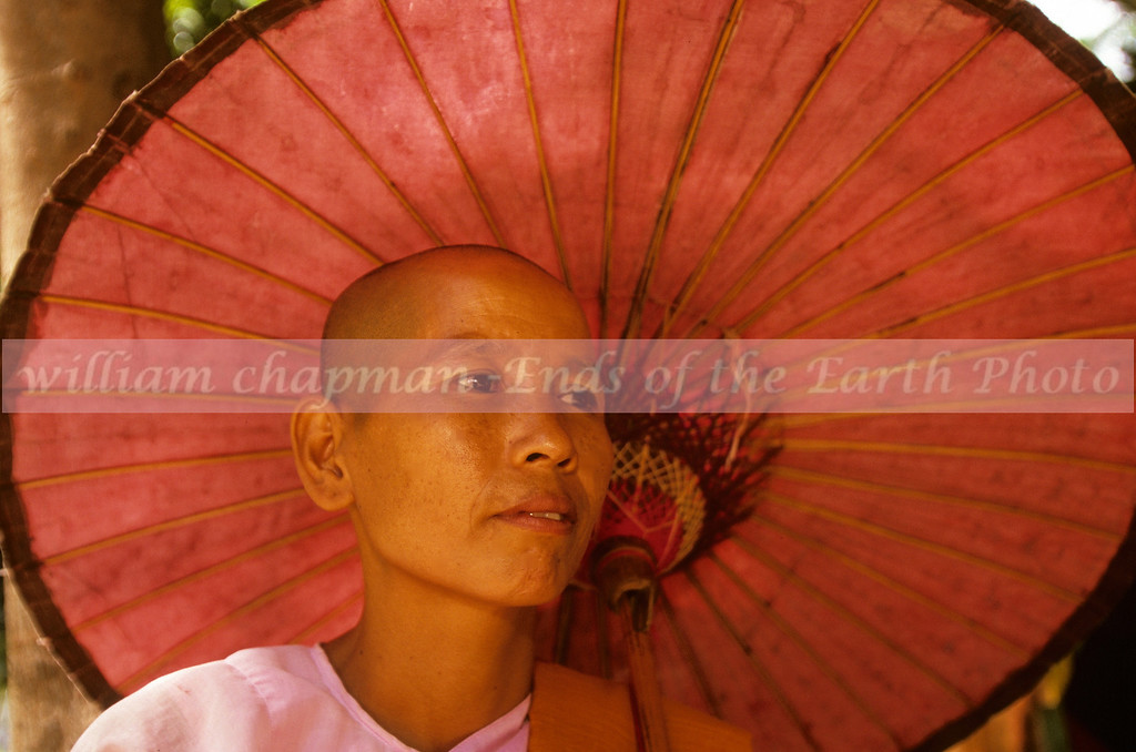 Nun with traditional Burmese umbrella