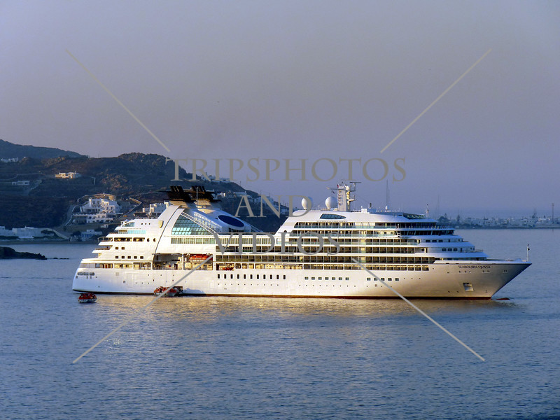 A cruise ship disembarks passengers on tender boats in Mykonos, Greece.