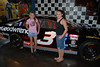 Bayley and Alyssa next to Dale Earnhardt's car in the NASCAR cafe
