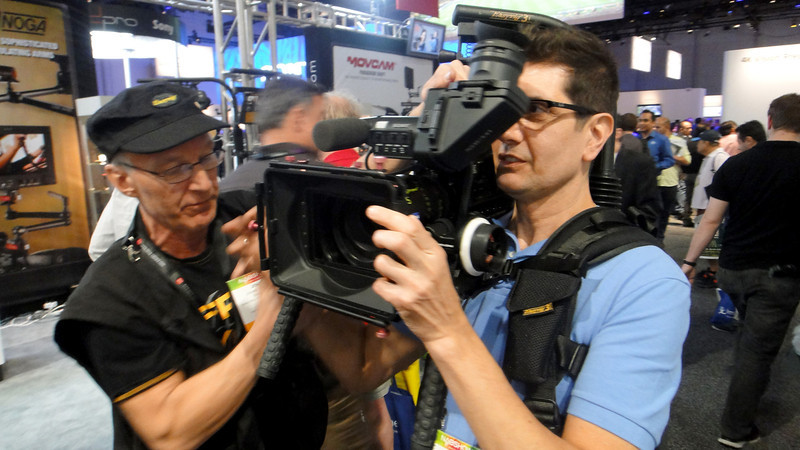 Associate Carl Hajik tries on some new camera gear making his job easier here at  NAB (National Association of Broadcasters) Show.